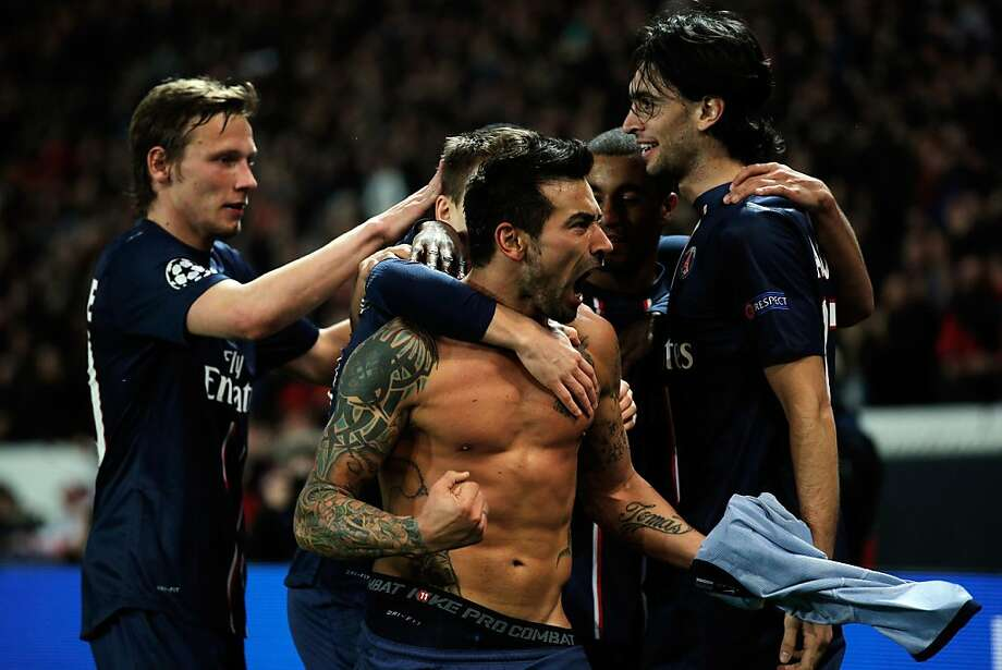 PARIS, FRANCE - MARCH 06:  Ezequiel Lavezzi of PSG takes off his shirt and celebrates with team mates after he scores his team first goal during the Round of 16 UEFA Champions League match between Paris St Germain and Valencia CF at Parc des Princes on March 6, 2013 in Paris, France.  (Photo by Dean Mouhtaropoulos/Getty Images) ***BESTPIX*** Photo: Dean Mouhtaropoulos, Getty Images