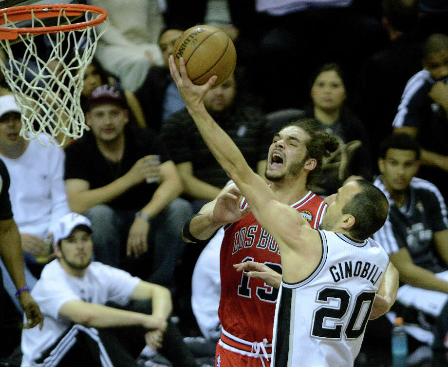 Manu Ginobili of the San Antonio Spurs scores on a layup as Joakim Noah of the Chicago Bulls reacts during first-half NBA action at the AT&T Center on Wednesday, March 6, 2013. Photo: Billy Calzada, San Antonio Express-News / San Antonio Express-News