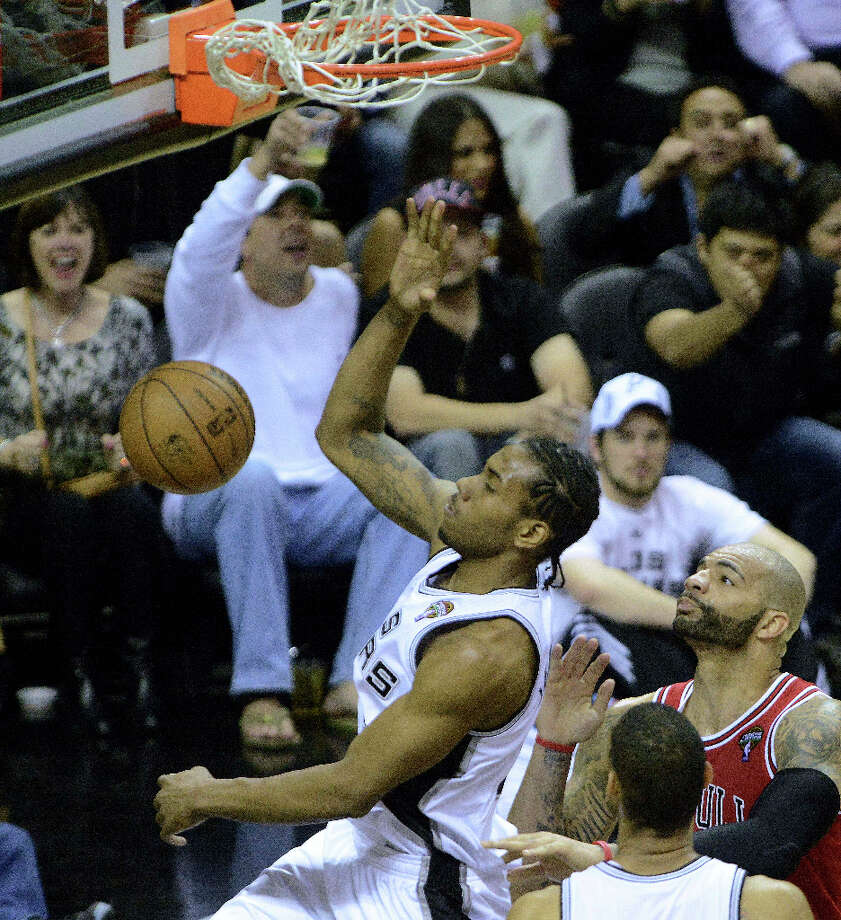 Kawhi Leonard of the San Antonio Spurs dunks against the Chicago Bulls during the final seconds of the first half in NBA action at the AT&T Center on Wednesday, March 6, 2013. Photo: Billy Calzada, San Antonio Express-News / San Antonio Express-News