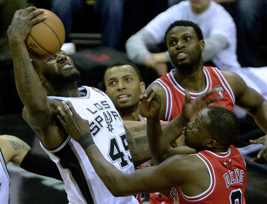 DeJuan Blair of the San Antonio Spurs battles Luol Deng of the Chicago Bulls for a rebound during NBA action at the AT&T Center on Wednesday, March 6, 2013. Photo: Billy Calzada, San Antonio Express-News / San Antonio Express-News