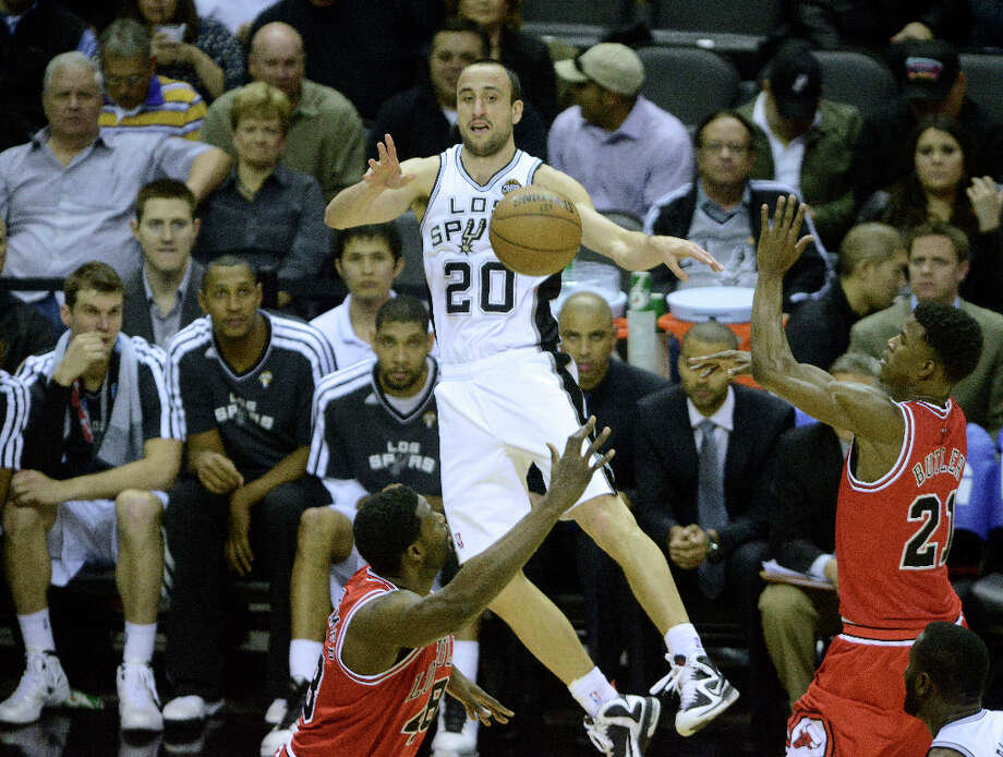 Manu Ginobili passes off against the Chicago Bulls during NBA action at the AT&T Center on Wednesday, March 6, 2013. Photo: Billy Calzada, San Antonio Express-News / San Antonio Express-News