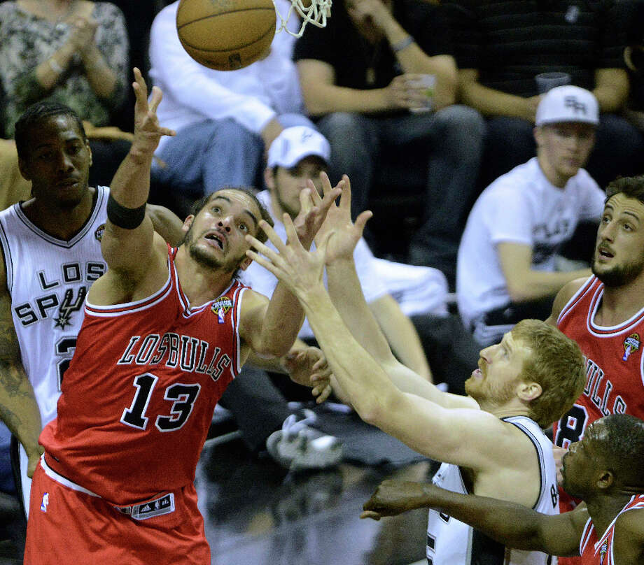 Joakim Noah (13) of the Chicago Bulls battles Matt Bonner of the San Antonio Spurs for a loose ball during NBA action at the AT&T Center on Wednesday, March 6, 2013. Photo: Billy Calzada, San Antonio Express-News / San Antonio Express-News