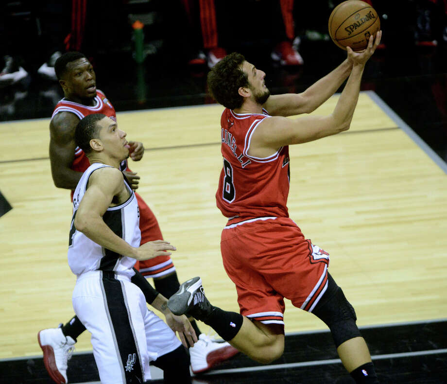 Marco Belinelli of the Chicago Bulls drives by Danny Green of the San Antonio Spurs during NBA action at the AT&T Center on Wednesday, March 6, 2013. Photo: Billy Calzada, San Antonio Express-News / San Antonio Express-News