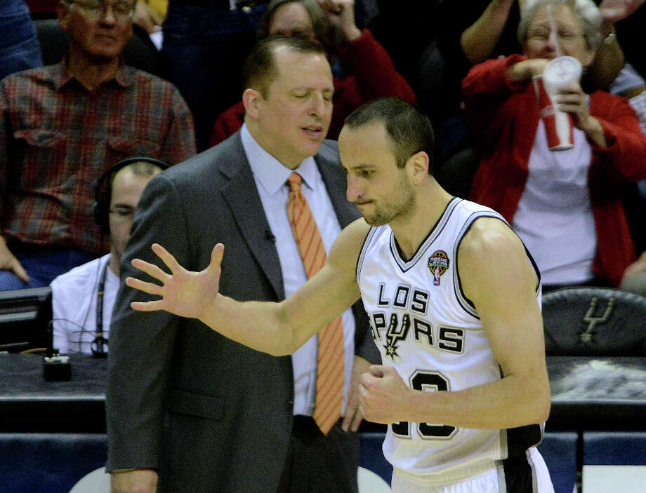 Manu Ginobili of the San Antonio Spurs and Chicago Bulls head coach Tom Thibodeau react after Ginobili scored on a second-half three-point shot during NBA action at the AT&T Center on Wednesday, March 6, 2013. Photo: Billy Calzada, San Antonio Express-News / San Antonio Express-News