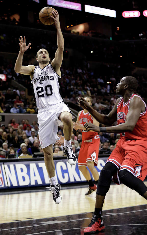 San Antonio Spurs' Manu Ginobili (20), of Argentina, shoots over Chicago Bulls' Luol Deng, right, during the first half of an NBA basketball game on Wednesday, March 6, 2013, in San Antonio. Photo: Eric Gay, Associated Press / AP