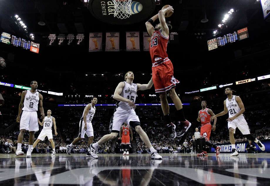 Chicago Bulls' Joakim Noah (13) scores over San Antonio Spurs defender Matt Bonner (15)during the first half of an NBA basketball game on Wednesday, March 6, 2013, in San Antonio. Photo: Eric Gay, Associated Press / AP