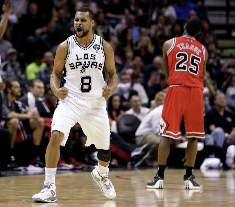 San Antonio Spurs' Patty Mills (8), of Australia, reacts after hitting a three-point basket over Chicago Bulls' Marquis Teague (25) during the second half of an NBA basketball game on Wednesday, March 6, 2013, in San Antonio. San Antonio won 101-83. Photo: Eric Gay, Associated Press / AP