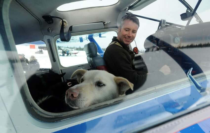 Iditarod Air Force pilot Scott Ivany prepares to leave the Nikolai, Alaska, airport with a load of d
