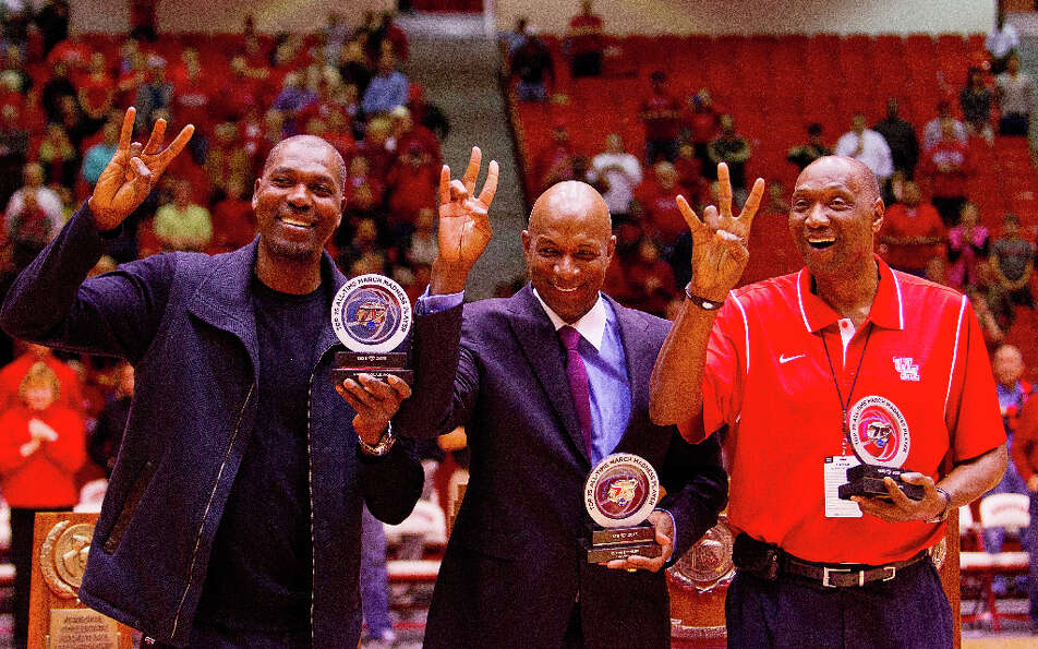 Hakeem Olajuwon, Clyde Drexler, and Elvin Hayes acknowledge the crowd during a halftime ceremony Wed
