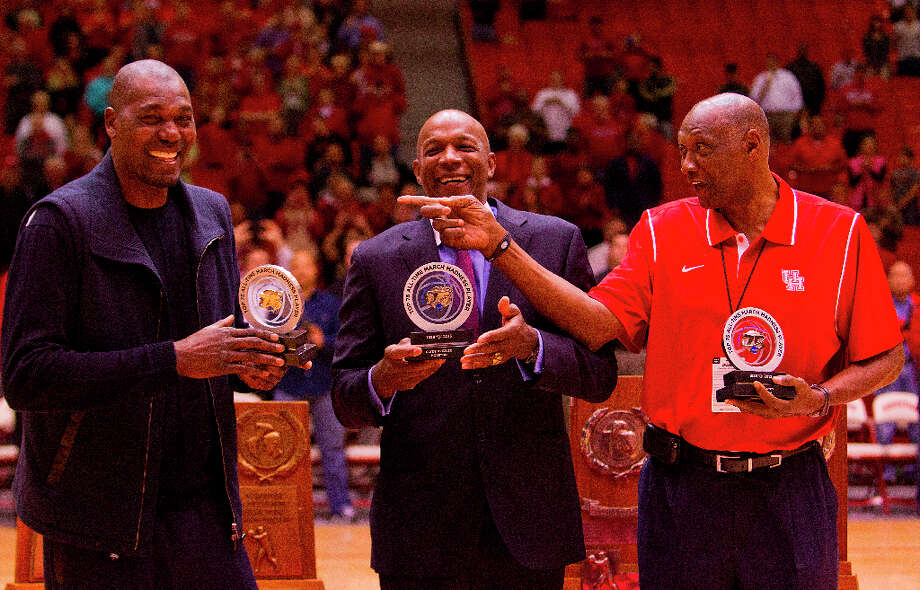Hakeem Olajuwon, Clyde Drexler, and Elvin Hayes are honored for their selections to the NCAA's top 75 all-time March Madness players during halftime at Hofheinz Pavilion. Hayes said he will take the final shot at Hofheinz Pavailion today, with an assist from Olajuwon. Photo: Billy Smith II, Houston Chronicle / © 2013 Houston Chronicle