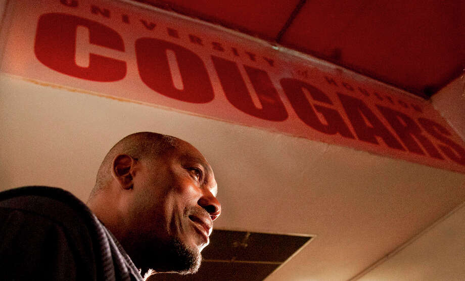 Houston basketball great Hakeem Olajuwon stands in the tunnel to the locker rooms at Hofheinz Pavillion while being interviewed by reporters. Photo: Billy Smith II, Houston Chronicle / © 2013 Houston Chronicle