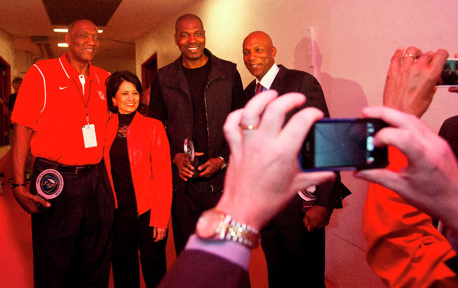 Elvin Hayes, left, takes a photo with University of Houston president Renu Khator, Hakeem Olajuwon, and Clyde Drexler. Photo: Billy Smith II, Houston Chronicle / © 2013 Houston Chronicle
