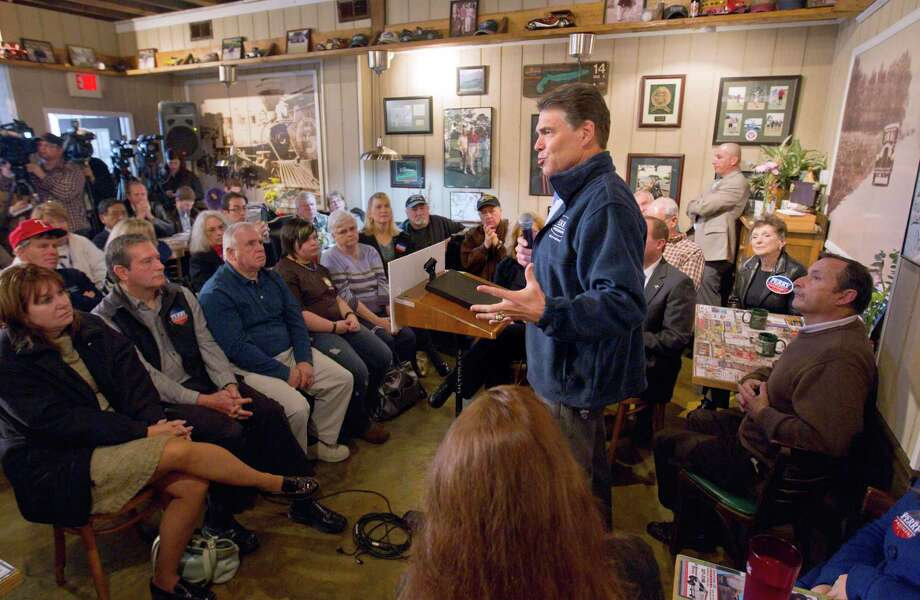 At a November 2011 town hall meeting in Goffstown, N.H., Perry got both the election date and voting age wrong when talking to university students. Photo: David Goldman, Associated Press / AP