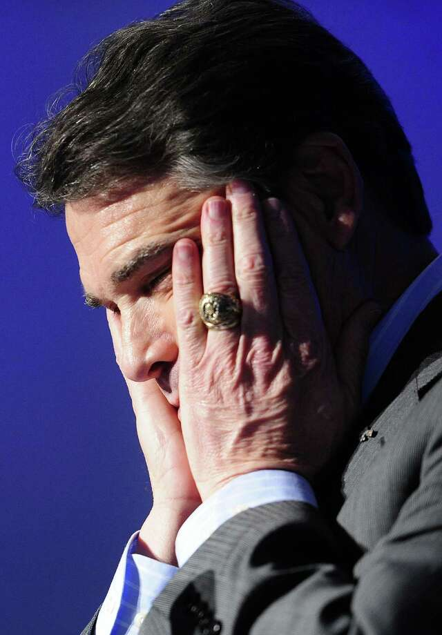 Oops! The mistake heard across the country as Perry failed to name one of the federal agencies he would eliminate if elected. Photo: EMMANUEL DUNAND, AFP/Getty Images / AFP