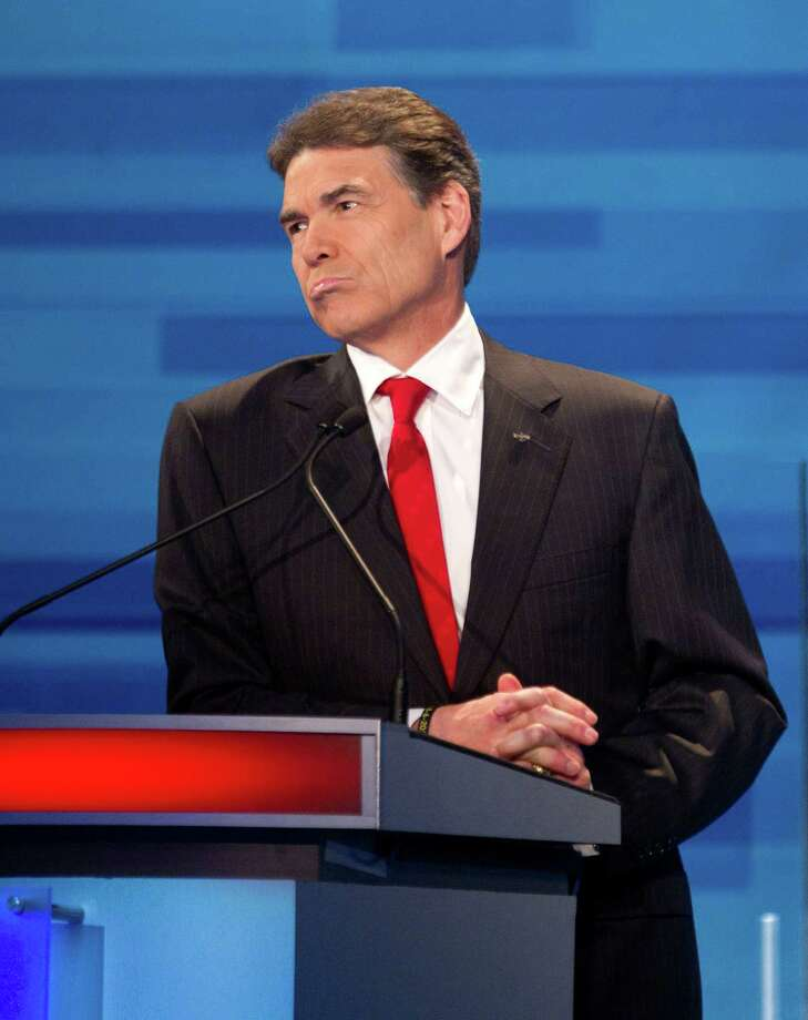 In a New Hampshire GOP debate, Perry said he would send troops back to Iraq, drawing criticism. Photo: David Goldman, Associated Press / AP