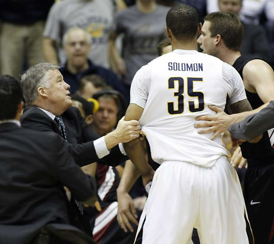 California head coach Mike Montgomery, left, holds Richard Solomon's (35) arm during a brawl in the second half of an NCAA college basketball game against Stanford, Wednesday, March 6, 2013 in Berkeley, Calif. Player at right is Stanford's Andy Brown. Stanford beat California 83-70. (AP Photo/George Nikitin) Photo: George Nikitin, Associated Press