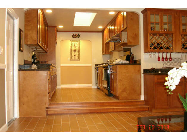 Kitchen is separated from the living area by a couple of steps.