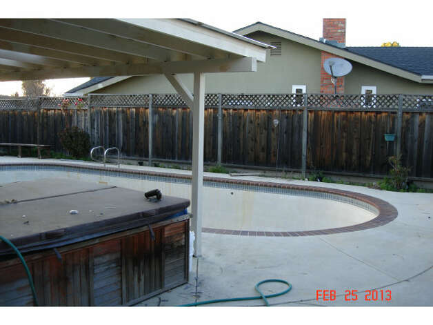 The 7,420 square foot lot has an in-ground pool and covered jacuzzi