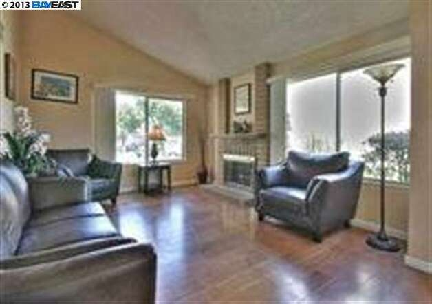 Interior pics are fuzzy - the living area of this 4 bedroom, 2.5 bathroom home.