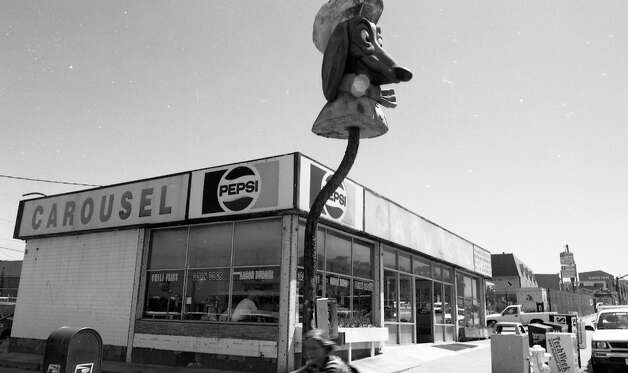 CAROUSEL RESTAURANT: The last Doggie Diner head remained on Sloat Boulevard in San Francisco, even after it changed into a Carousel Restaurant. This is the Doggie Diner I remember the most, seeing it from our bus when we drove from the Peninsula to visit the SF Zoo. Pictured in 1996. Photo: Lea Suzuki, The Chronicle / ONLINE_YES
