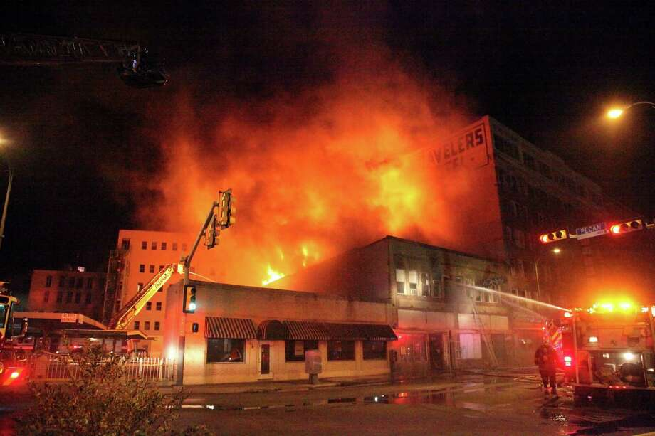 A fire broke out downtown after 7p.m. The fire appeared to have started in the former Frisky-A-Go-Go club in the 200 block of Broadway. Wednesday March 6, 2013 Photo: Juanito M Garza, San Antonio Express-News / San Antonio Express-News