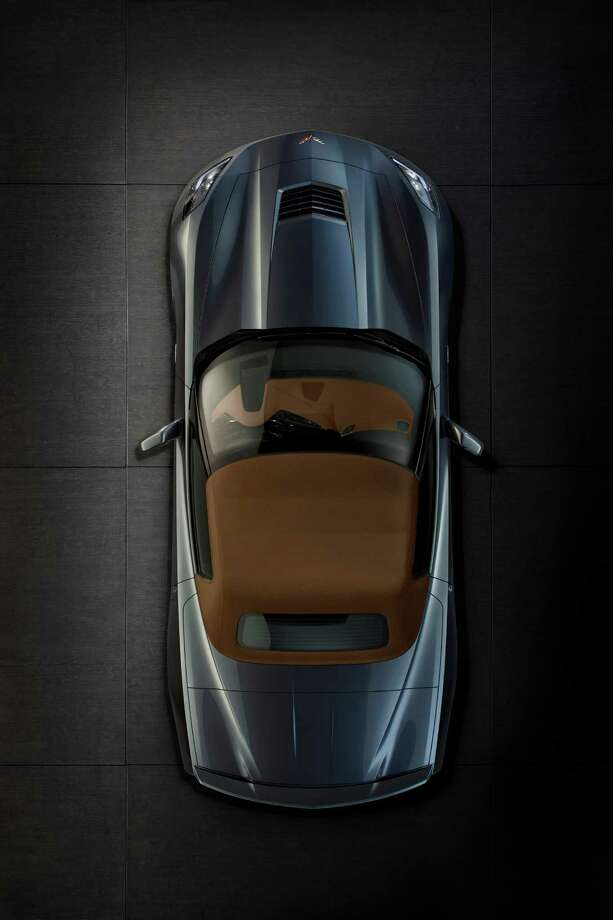 With the top up, the 2014 Corvette Stingray convertible is designed for a refined driving experience. A thick, three-ply fabric top, along with sound-absorbing padding and a glass rear window, contributes to a quiet cabin and premium appearance. Photo: Alan Vanderkaay, Chevrolet