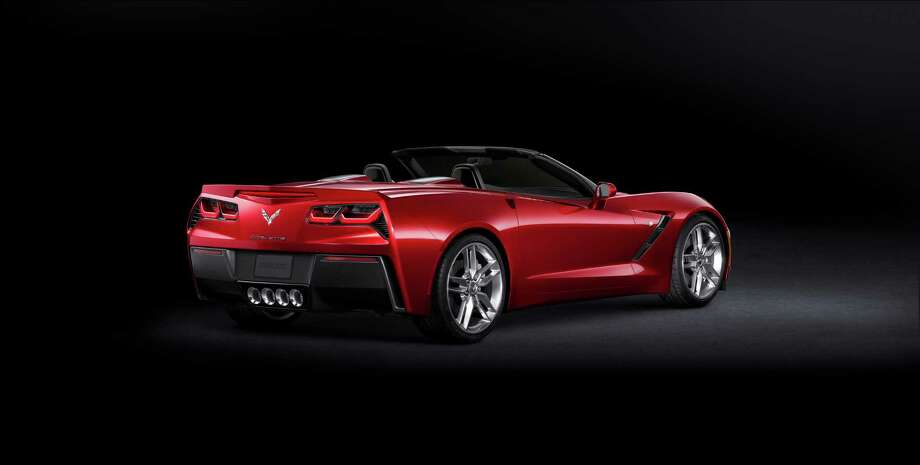 "With the top down, the 2014 Chevrolet Corvette Stingray's signature profile is further accentuated. Behind the seat backs, dual black accent panels enhance the character lines of the tonneau cover. Corvette Stingray's signature ""waterfall"" design originates in the valley between the nacelles, bringing the exterior color into the interior. Photo: Chevrolet"