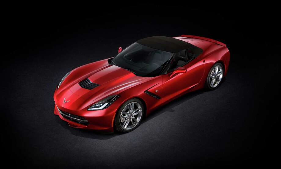 With the top up, the 2014 Corvette Stingray convertible is designed for a refined driving experience. A thick, three-ply fabric top, along with sound-absorbing padding and a glass rear window, contributes to a quiet cabin and premium appearance. Photo: Chevrolet
