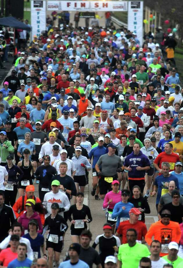 Thousands of people turn out to run the Gusher Marathon in Beaumont, Saturday, March 10, 2012. Tammy McKinley/The Enterprise Photo: TAMMY MCKINLEY