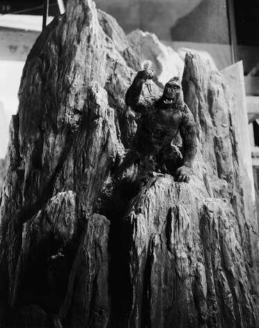 "John Cerisoli's model of the giant ape climbs a mountain carrying a miniature Fay Wray doll, in a scene from the classic monster movie ""King Kong."" Photo: Ernest Bachrach, Getty Images / Moviepix"