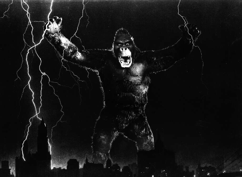 "One of John Cerisoli's models of the giant ape, poised above the New York skyline in a scene from the classic monster movie ""King Kong."" Photo: Ernest Bachrach, Getty Images / Moviepix"