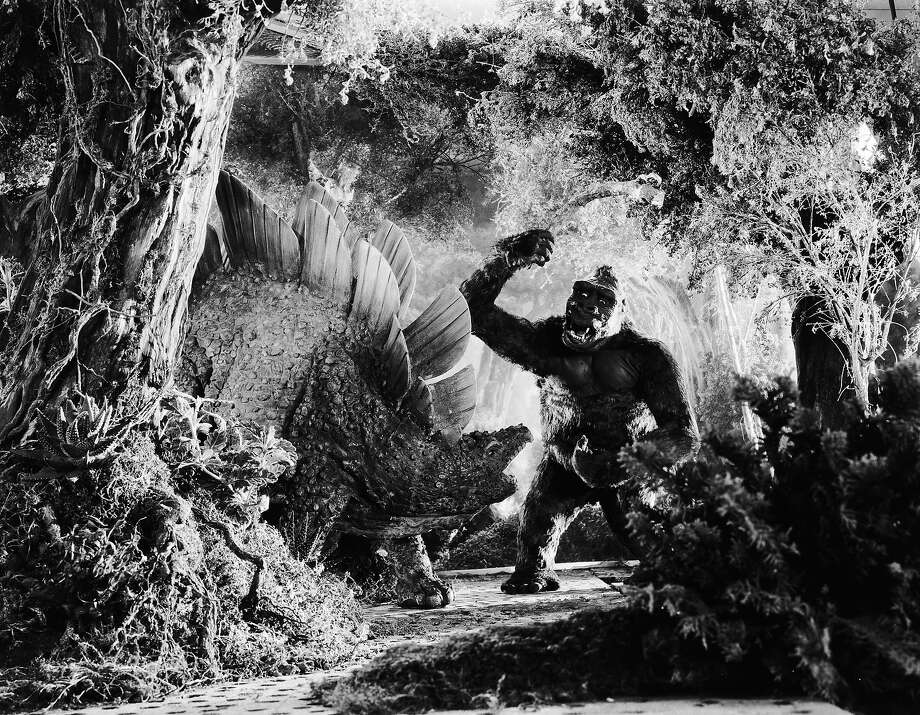 "John Cerisoli's models of a giant ape and a dinosaur battle it out in a scene from the classic monster movie ""King Kong."" Photo: Ernest Bachrach, Getty Images / Moviepix"
