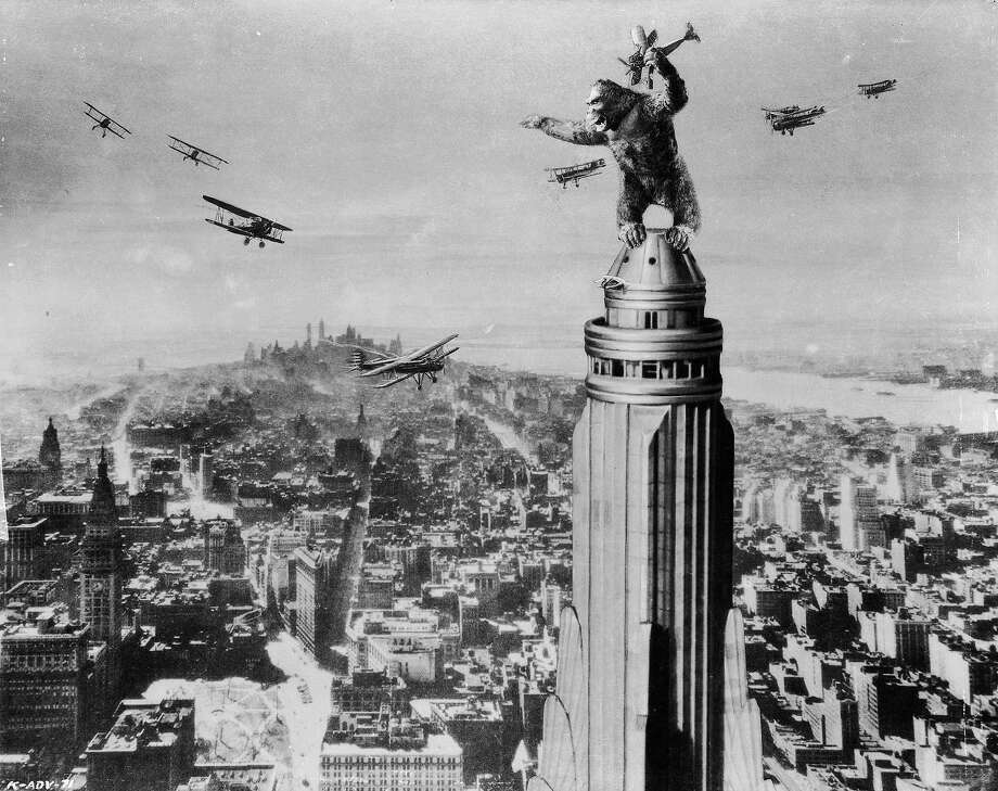 "One of John Cerisoli's models of the giant ape, poised atop a Manhattan skyscraper in a scene from the classic monster movie ""King Kong."" Photo: John Kobal Foundation, Getty Images / Moviepix"