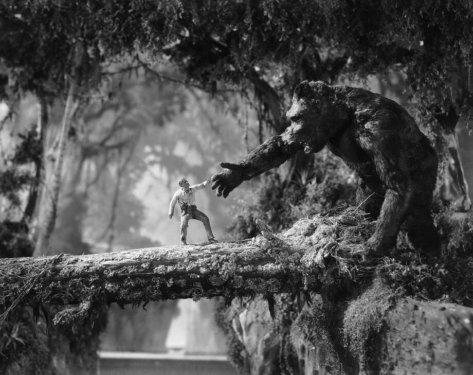 "Man meets giant ape across a fallen tree branch in a scene from the classic monster movie ""King Kong."" Photo: Ernest Bachrach, Getty Images / 2007 Getty Images"