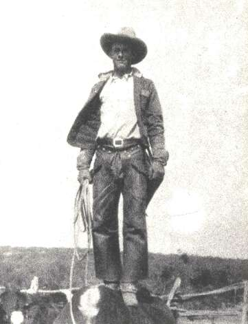 Clarence Hyde, YO Ranch cowboy and later ranch foreman. He appears to be standing on the back of an animal. Photo: Courtesy Of Joe Herring Jr. / Courtesy of Joe Herring Jr.