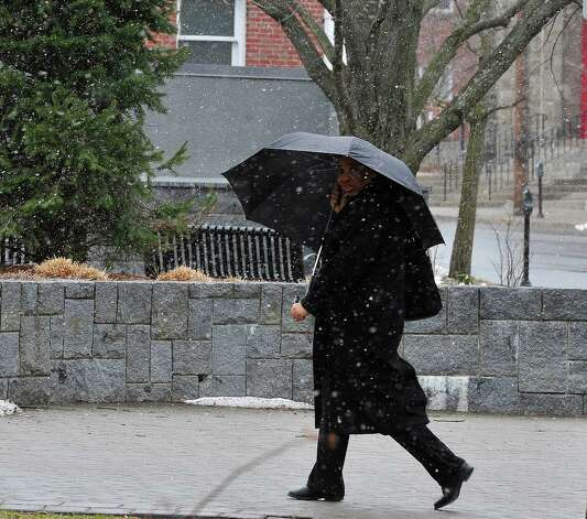 Irene Xeketwana makes her way through Thursday's snow in Danbury, Conn. March 7, 2013. Photo: Michael Duffy / The News-Times