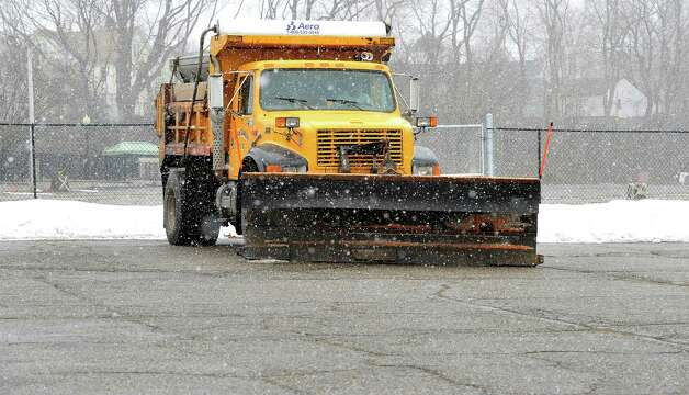 A city plow waits for enough snow to plow during Thursday's snow in Danbury, Conn. March 7, 2013. Photo: Michael Duffy / The News-Times