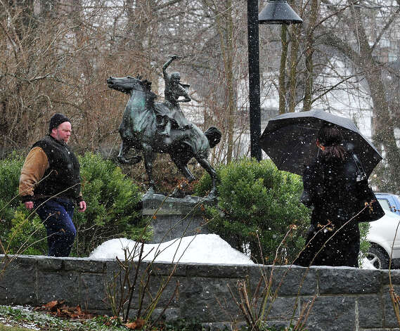Patrons of the Danbury Library pass a statue of Sybil Luddington as they make their way through Thursday's snow in Danbury, Conn. March 7, 2013. Photo: Michael Duffy / The News-Times