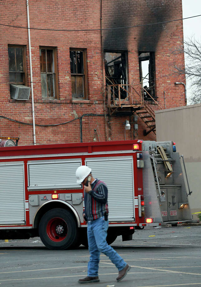 A fire truck is parked Thursday morning March 7, 2013 behind the old Frisky-A-Go-Go Club next to the Traveler's Hotel in the 200 block of Broadway where a fire broke out Wednesday night. Photo: JOHN DAVENPORT, SAN ANTONIO EXPRESS-NEWS / ©San Antonio Express-News/Photo may be sold to the public