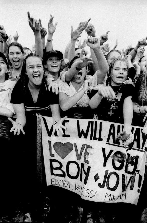 Bon Jovi fans cheer and shout in the front rows of the audience while watching the band perform an open air concert in 1996 in Landgraaf, Netherlands. Photo: Paul Bergen, Getty Images / 1996 Paul Bergen
