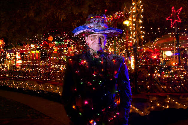 Ed Clark stands infront of his home, 14106 Short Horn, that he has decorated with thousands of lights both inside and out. Photo: EDWARD A. ORNELAS, SAN ANTONIO EXPRESS-NEWS / SAN ANTONIO EXPRESS-NEWS