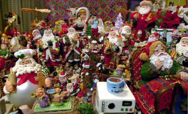 Edward Clark's kitchen table that is filled with Santa Claus figurines at his home. Photo: EDWARD A. ORNELAS, EN / EN