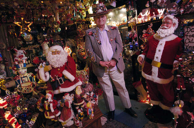 Ed Clark decorated his entire house with Christmas lights and decor year-round in honor of his wife, Francis, who passed away over 20 years ago. Clark said his wife loved Christmas. Every season he lets kids tour his fantastic display. Photo: KIN MAN HUI, SAN ANTONIO EXPRESS-NEWS / SAN ANTONIO EXPRESS-NEWS