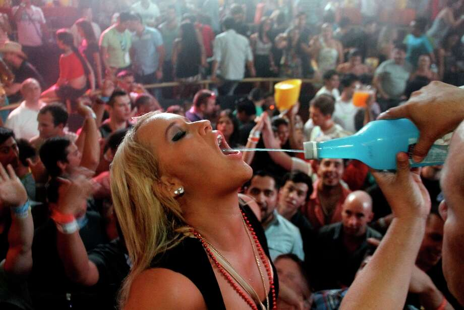 A spring break reveler gets a drink at a bar in the resort city of Cancun, Mexico, early Tuesday Feb. 26, 2013. Cancun is one of the No. 1 foreign destination for U.S. college students wanting to enjoy spring break. Photo: Israel Leal, Associated Press / AP
