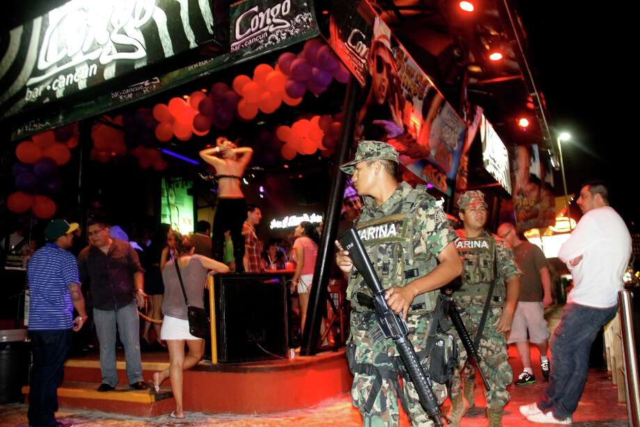 Mexican navy marines patrol the nightclub district as spring breakers party in Cancun early Tuesday, Feb. 26, 2013. Photo: Israel Leal, Associated Press / AP