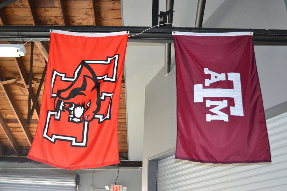UH and Texas A&M flags adorn the brewery.