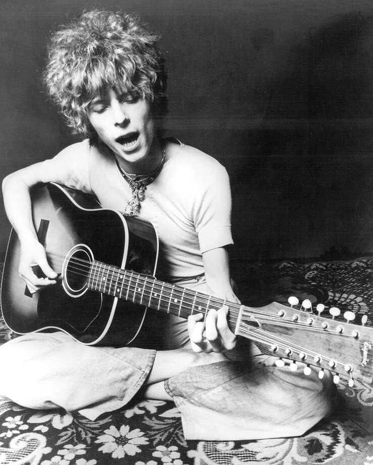 "Musician David Bowie plays an acoustic Espana 12-string guitar to promote the release of his album ""Space Oddity"" in November 1969 in London, England. Photo: Michael Ochs Archives, Getty Images / Michael Ochs Archives"