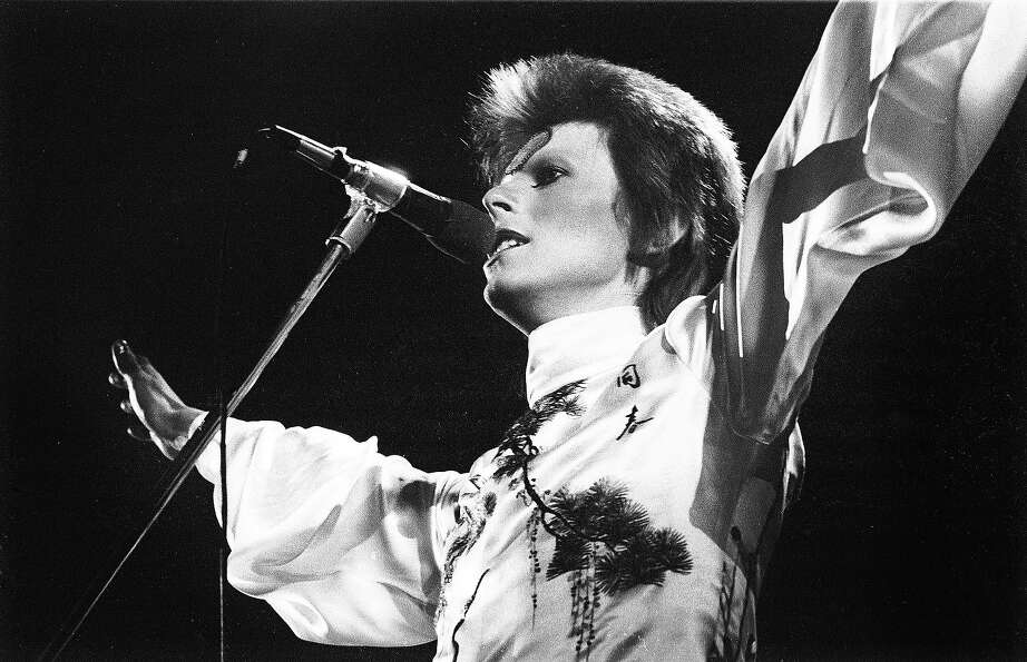 David Bowie performs live on stage at Earls Court Arena in 1973 during the Ziggy Stardust tour.