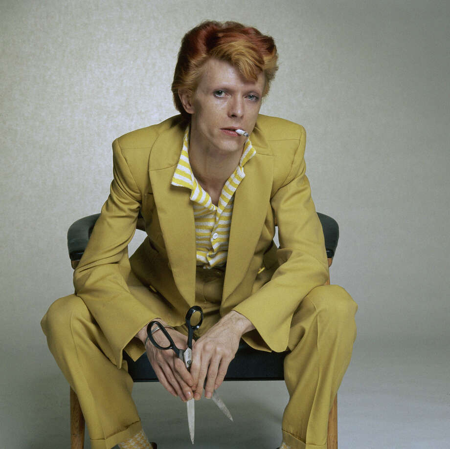 English singer, musician and actor David Bowie with dyed red hair and a yellow suit, circa 1974. Photo: Terry O'Neill, Getty Images / 2006 Getty Images