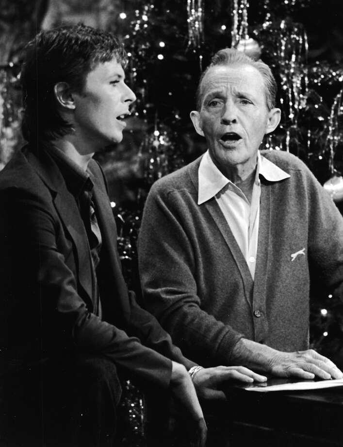 British rock singer and actor David Bowie performs with American pop singer Bing Crosby for the TV special, 'Bing Crosby's Merrie Olde Christmas,' London, England. Photo: CBS Photo Archive, Getty Images / 2003 Getty Images